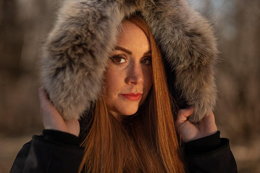 woman in black and gray fur coat