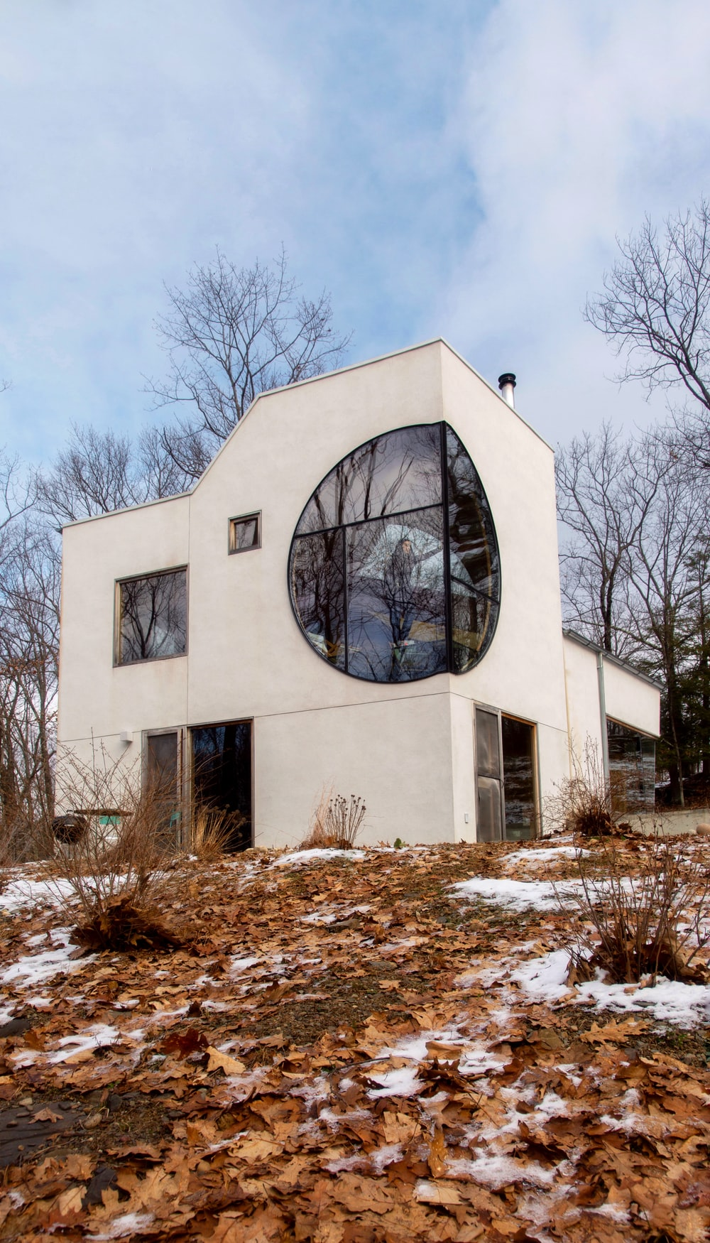 white concrete building with glass window