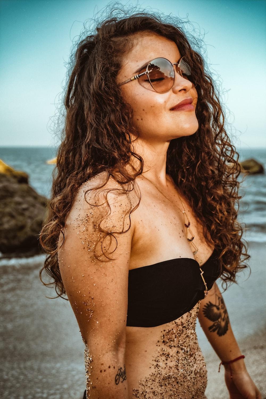 woman in black brassiere and black sunglasses