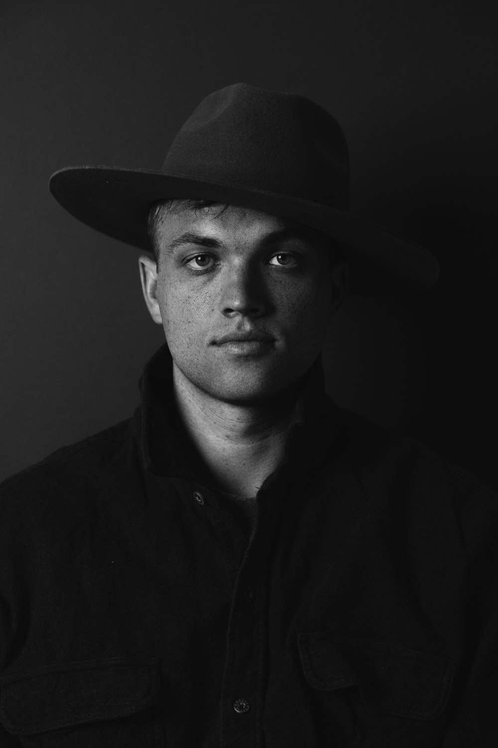 man in black hat and black button up shirt