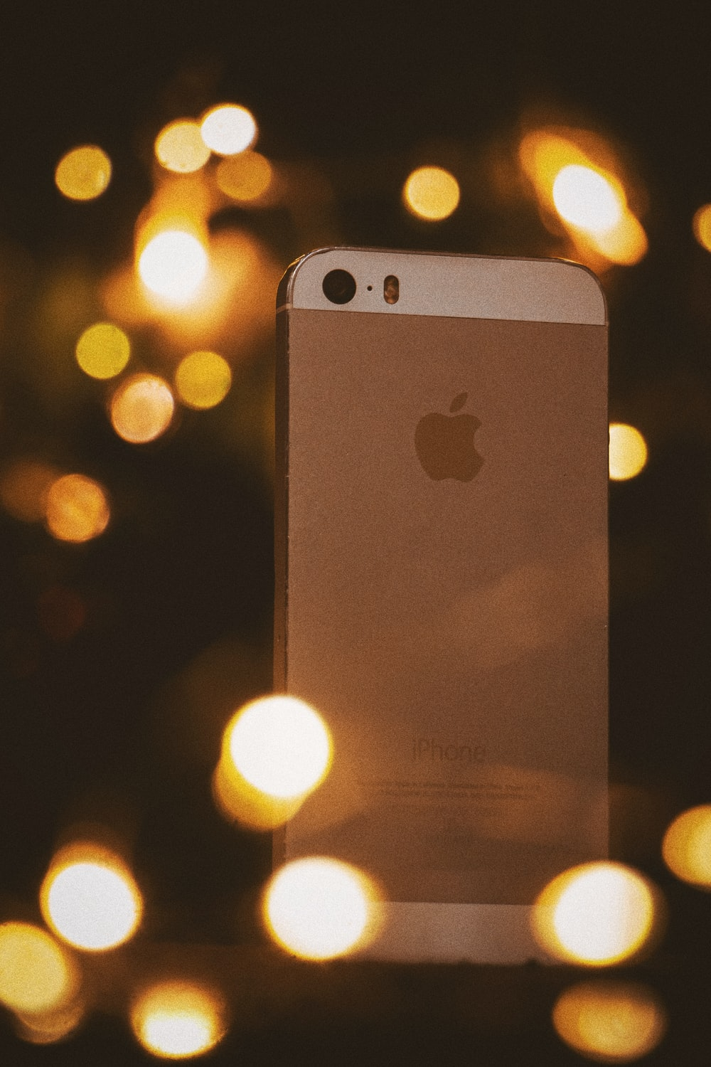 gold iphone 6 on bokeh photography