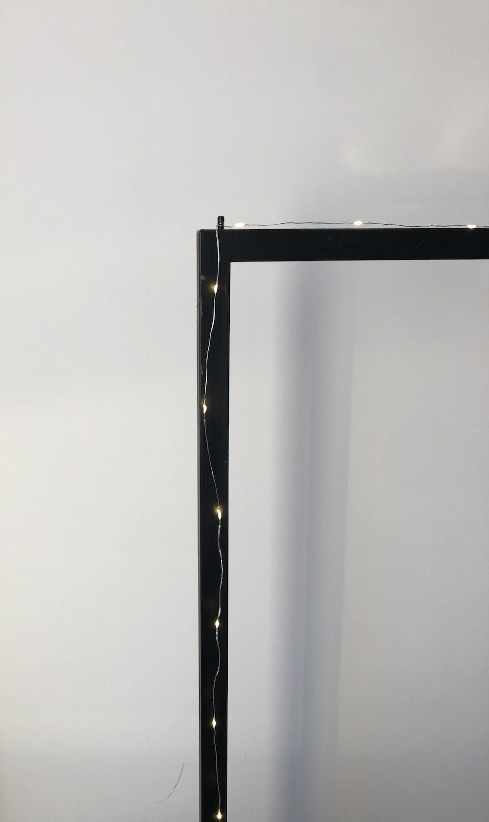 black metal frame near white wall