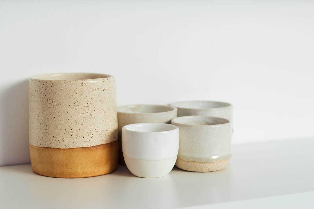 white and brown ceramic bowls