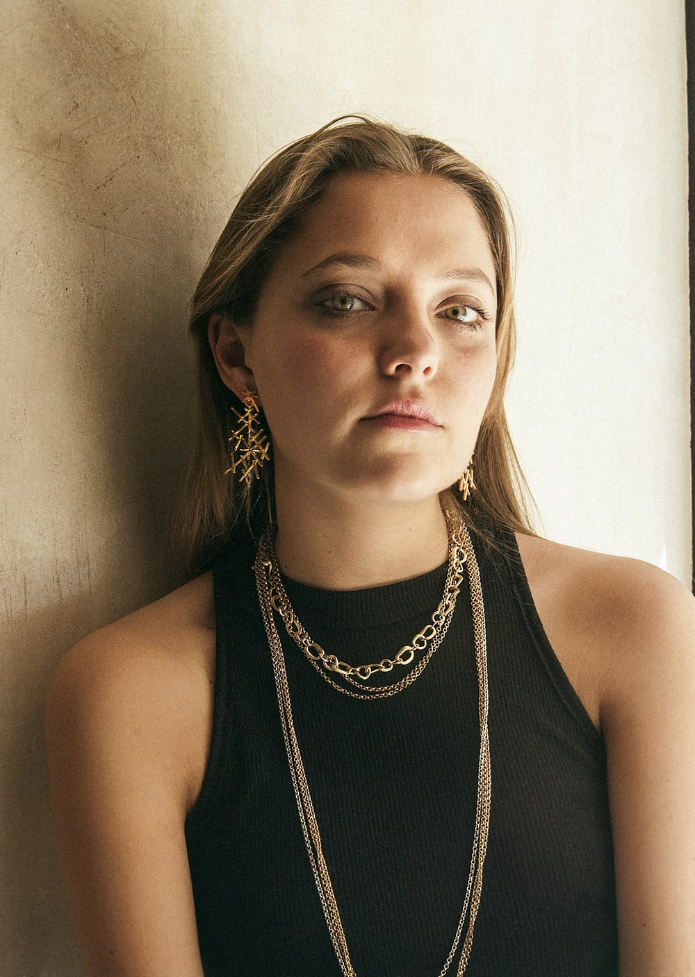 woman in black tank top wearing silver necklace