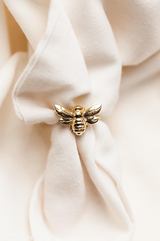 gold ring on white textile