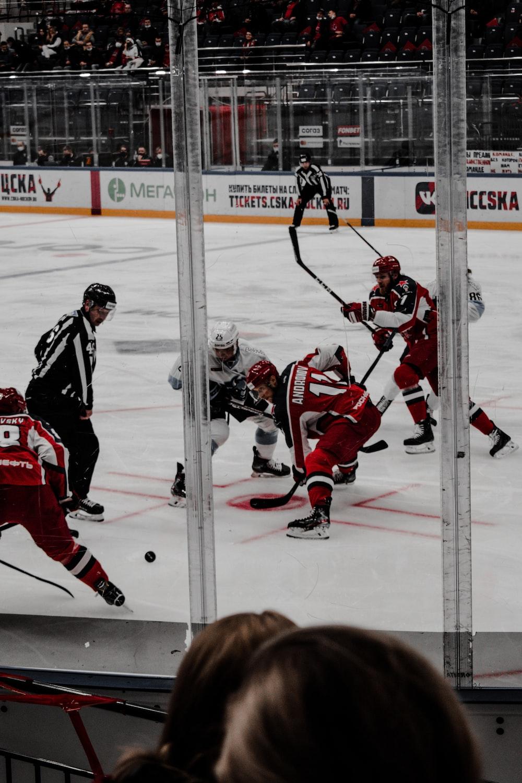 ice hockey players on ice hockey field