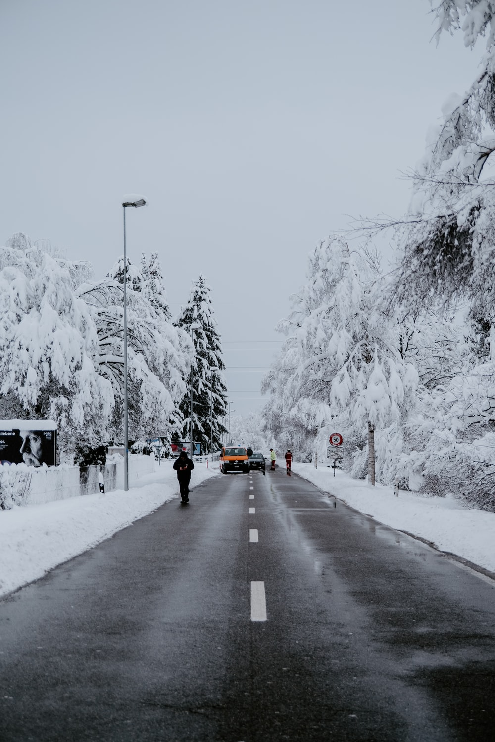 people walking on road covered with snow