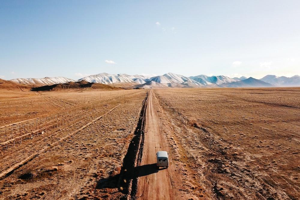black metal rail road on brown sand