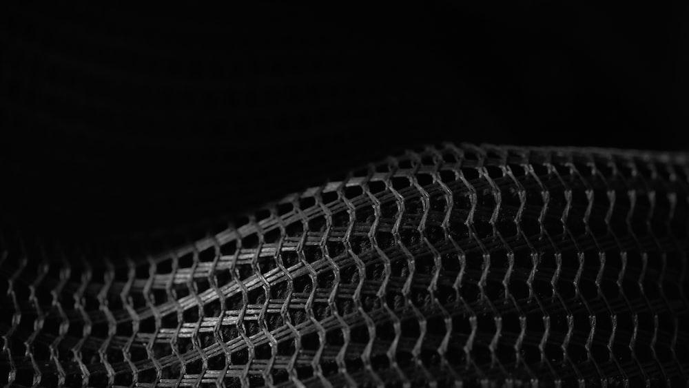 black and white textile in dark room