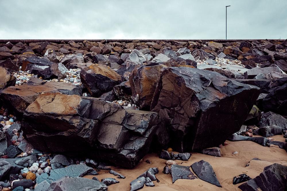 brown rocks on brown sand during daytime