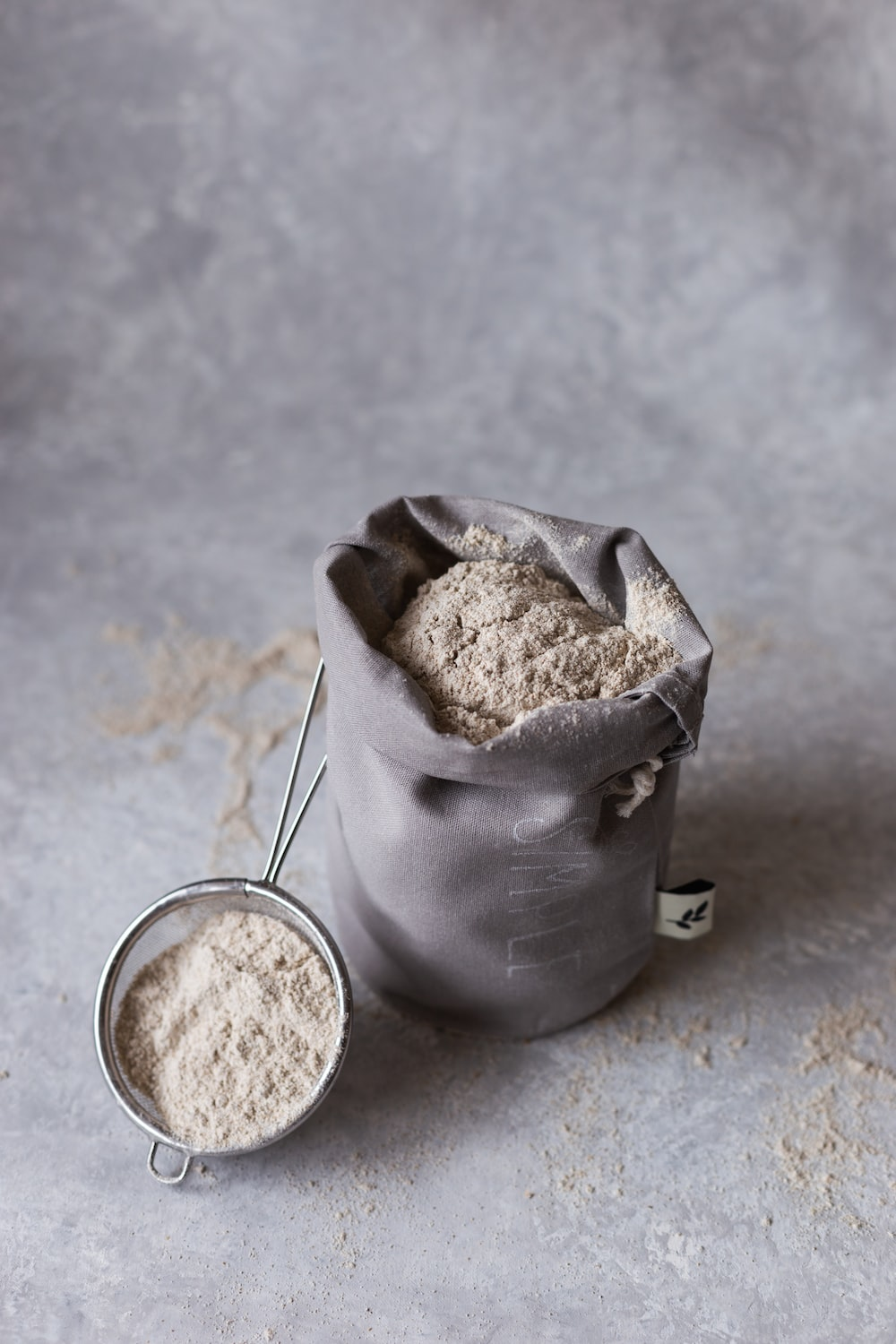 stainless steel cup with brown powder