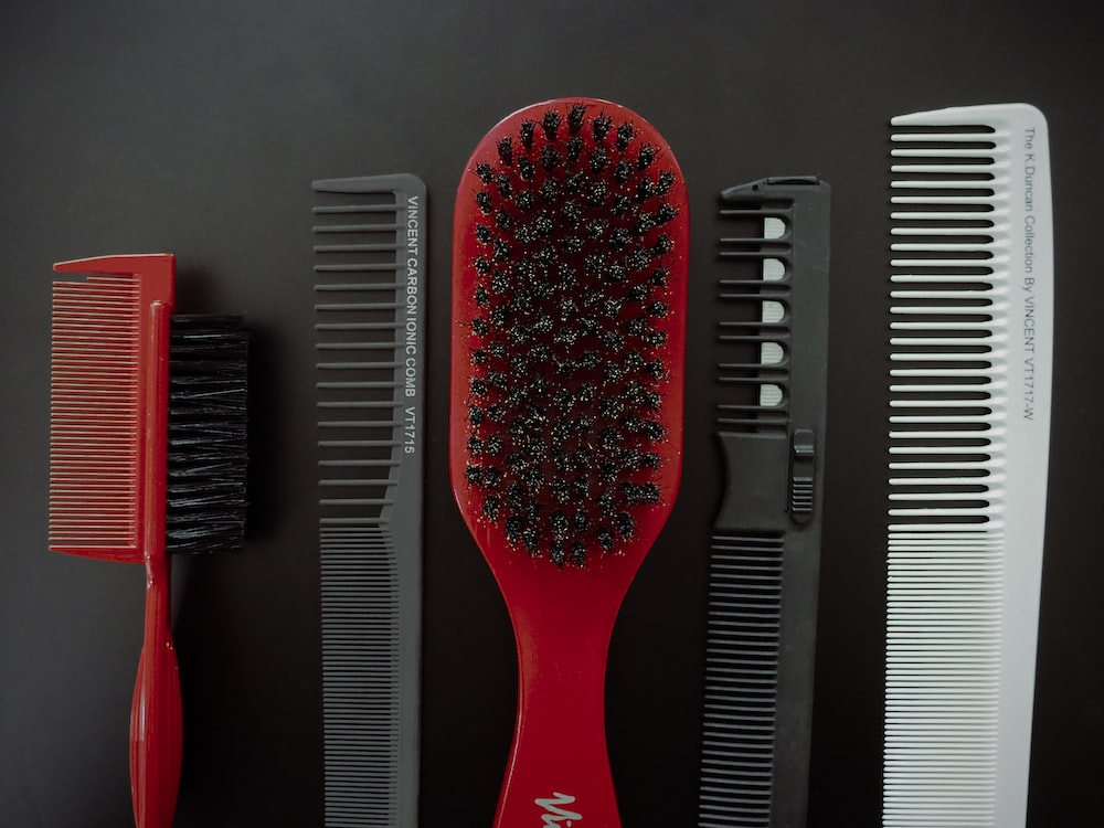 red and black hair brush