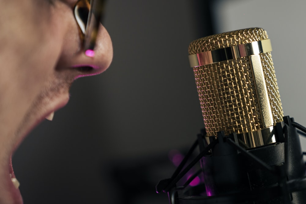 woman in black shirt holding microphone