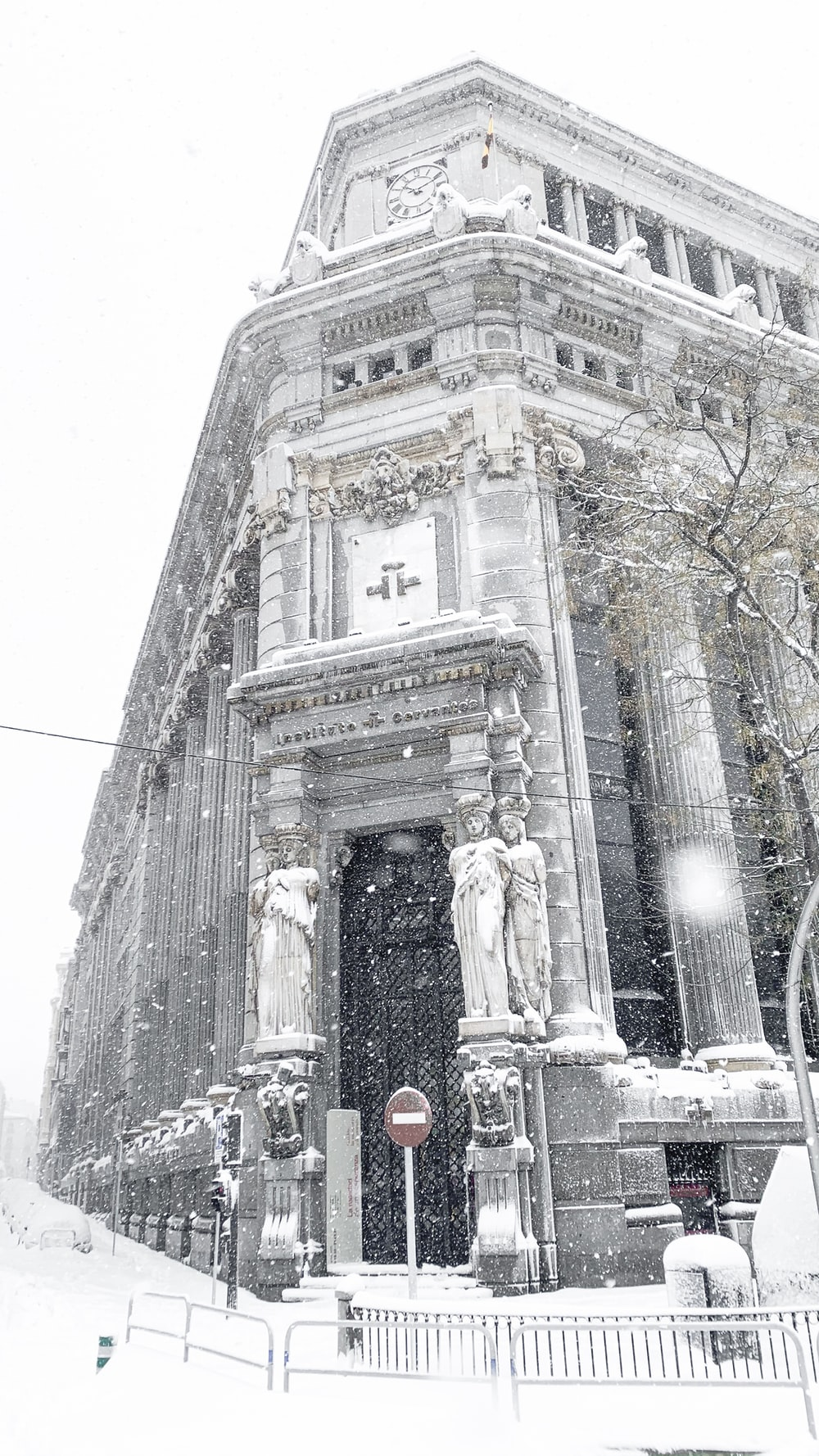 people walking near white concrete building during daytime