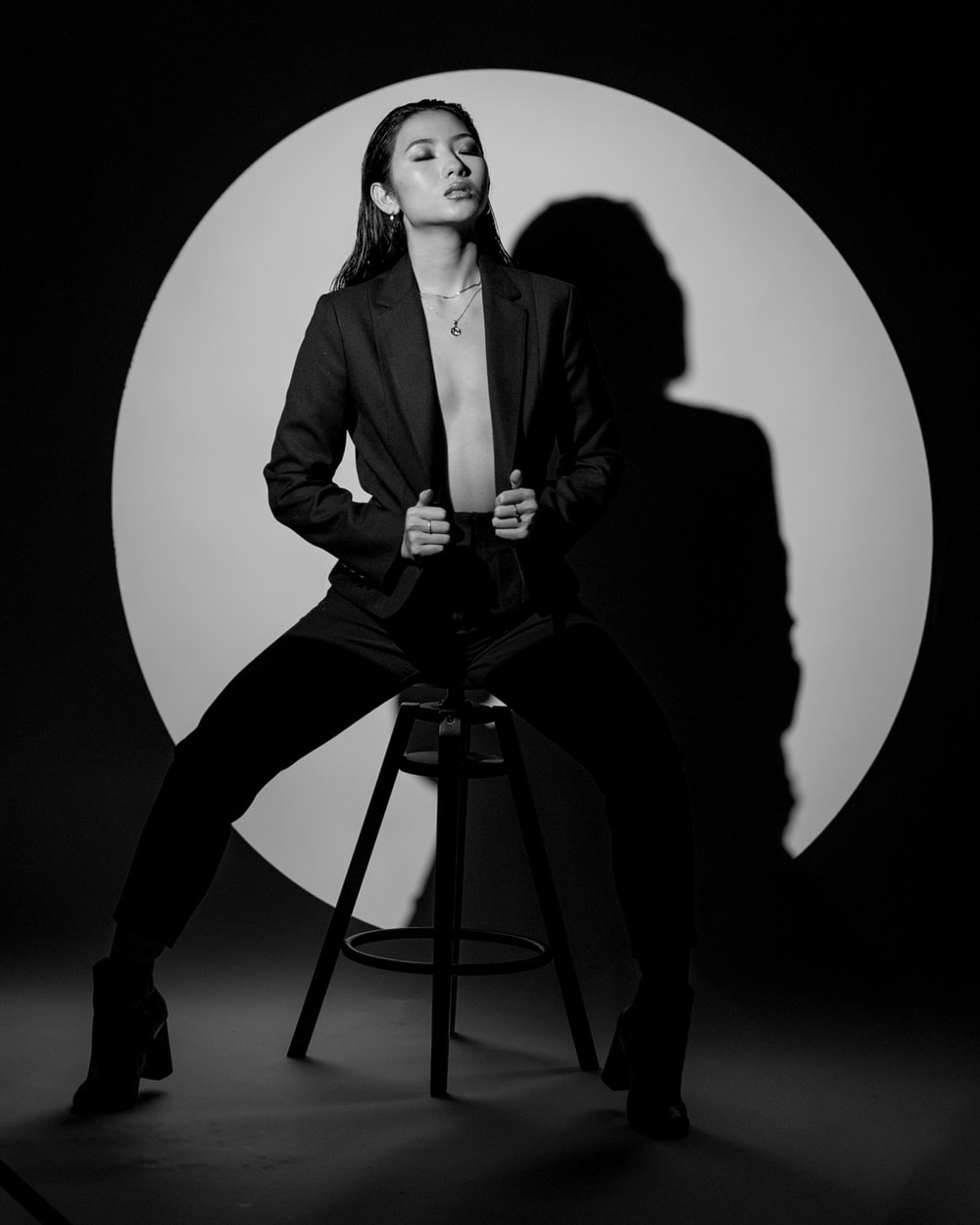 woman in black suit jacket sitting on seat