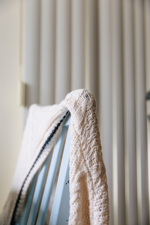 white textile on white window blinds