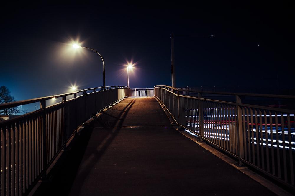 brown wooden bridge during night time