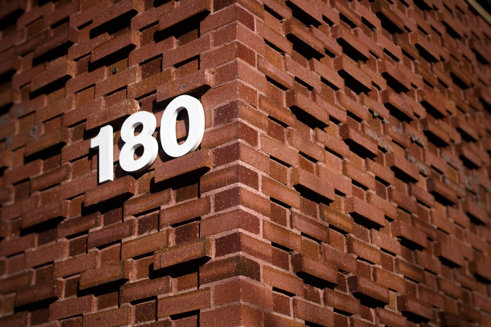 brown brick wall with number 10