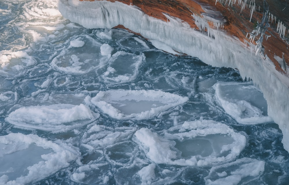 white ice on body of water