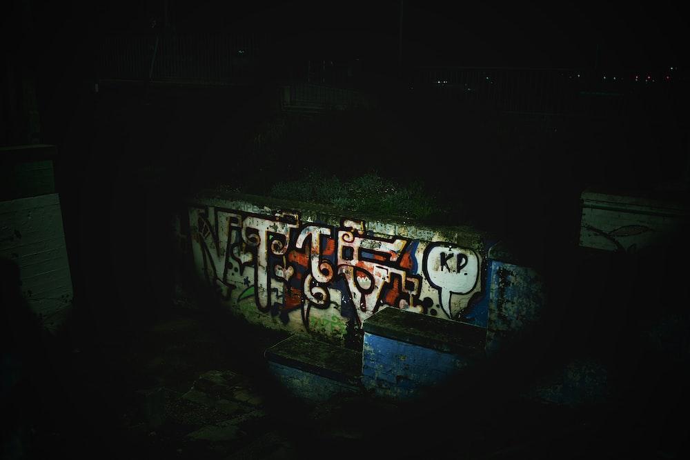 white and blue graffiti art