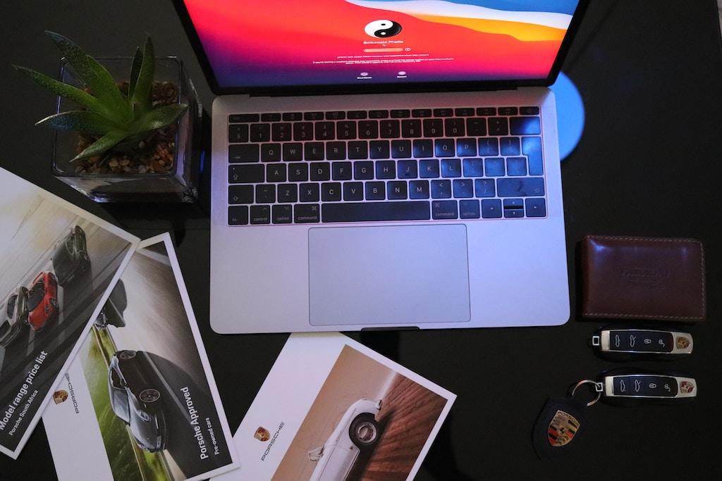 macbook pro on black table