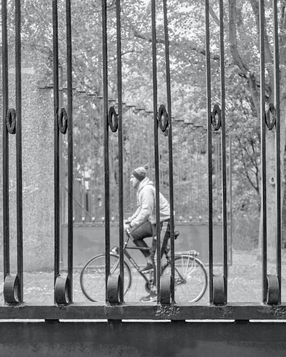 grayscale photo of girl riding bicycle