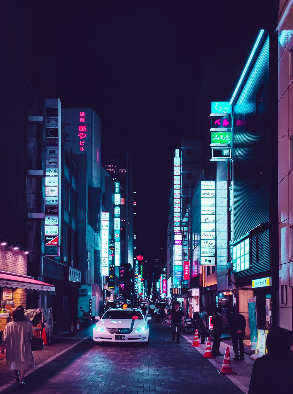people walking on street during night time