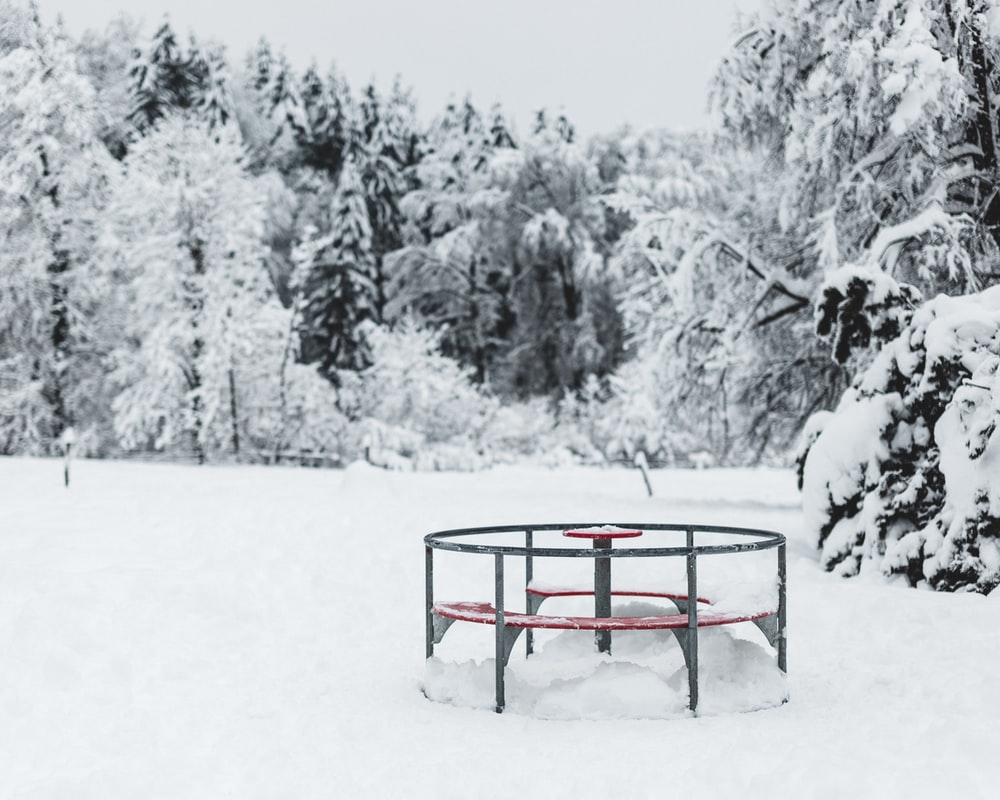 red metal frame on snow covered ground