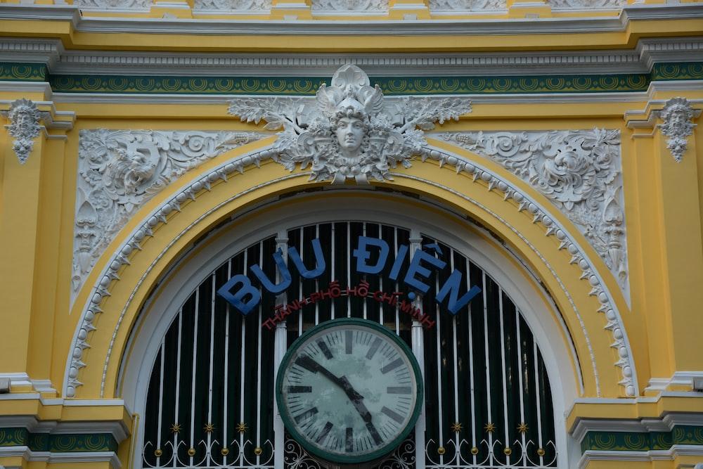 white and gold analog clock
