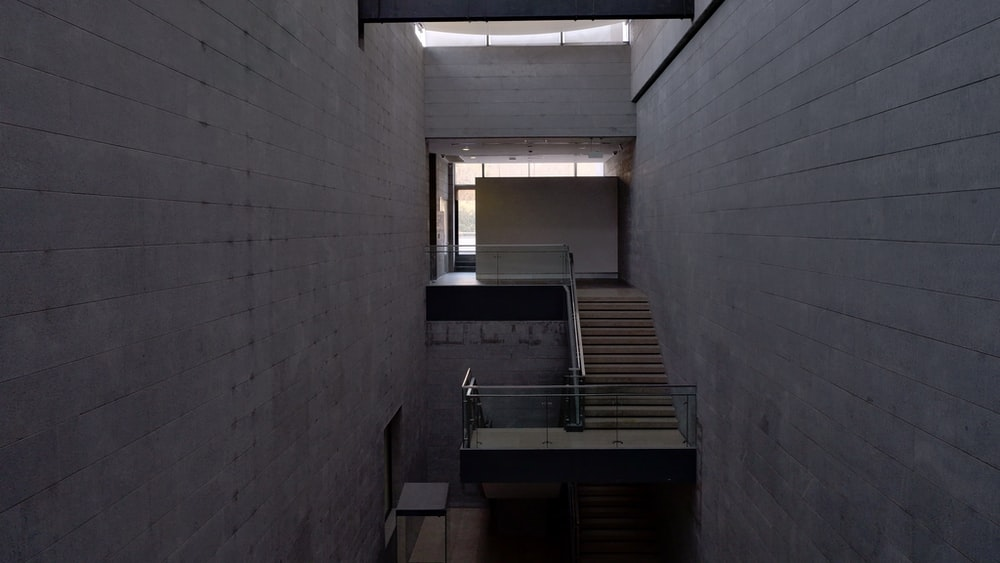 brown wooden stairs inside building