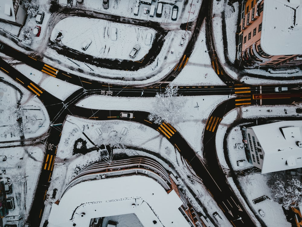 white and yellow cars on road