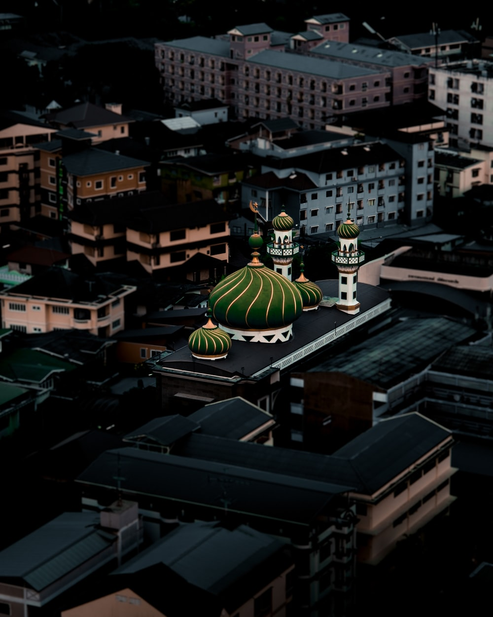 green and yellow dome building