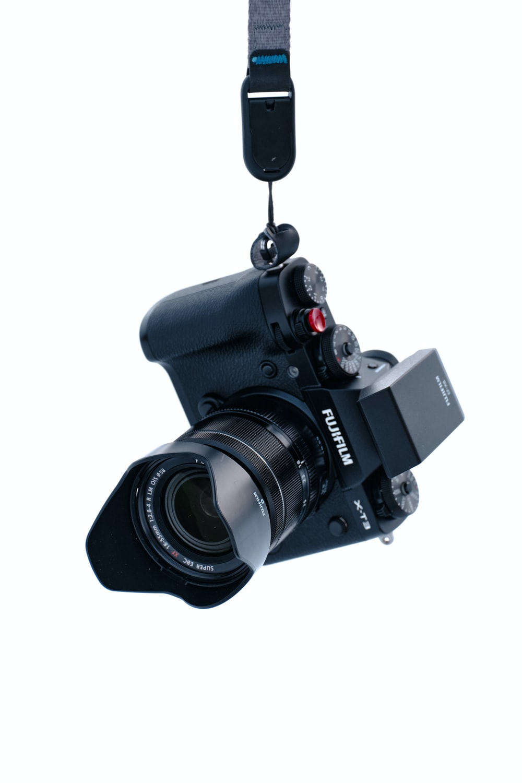 black dslr camera on white background