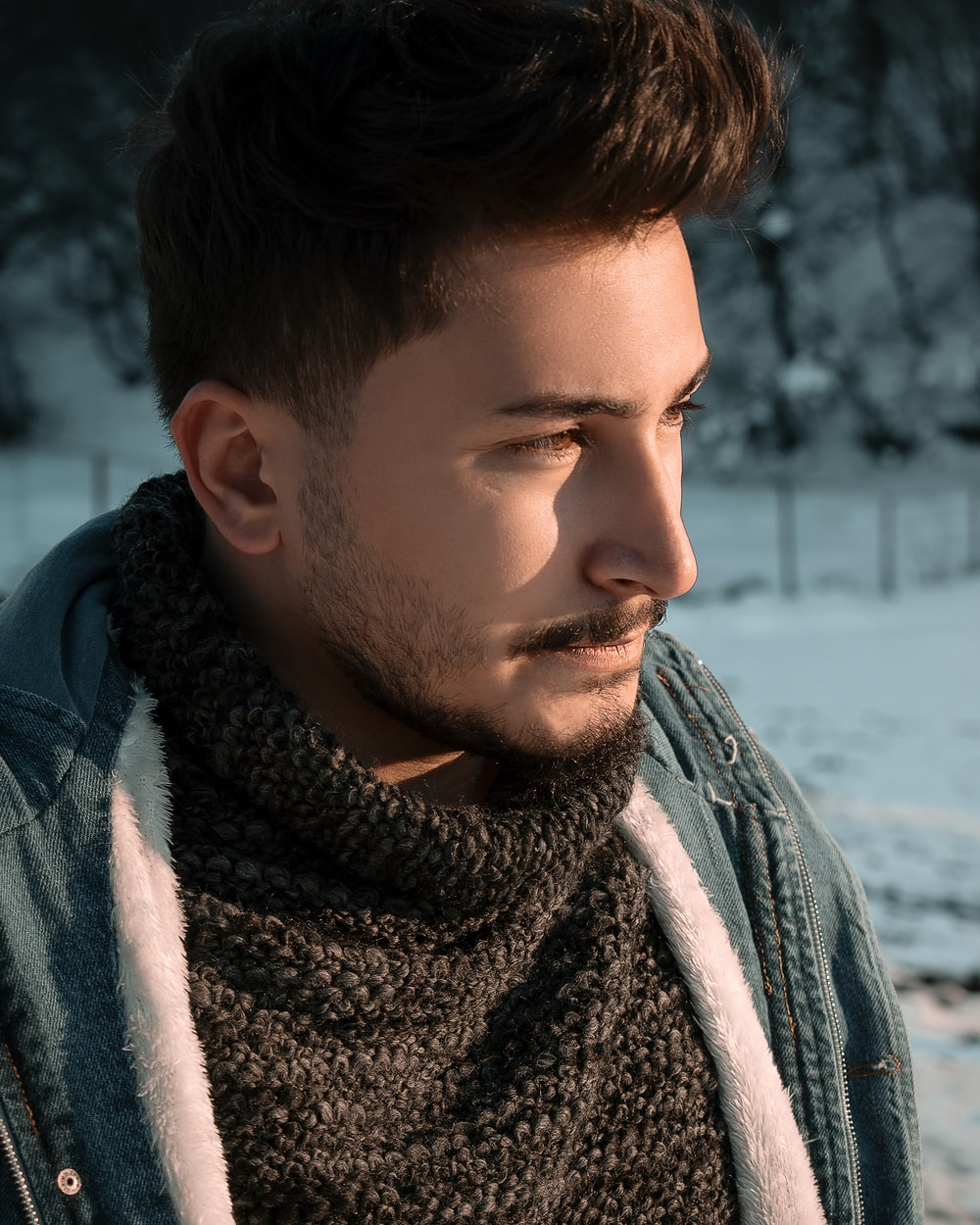 man in gray and white scarf