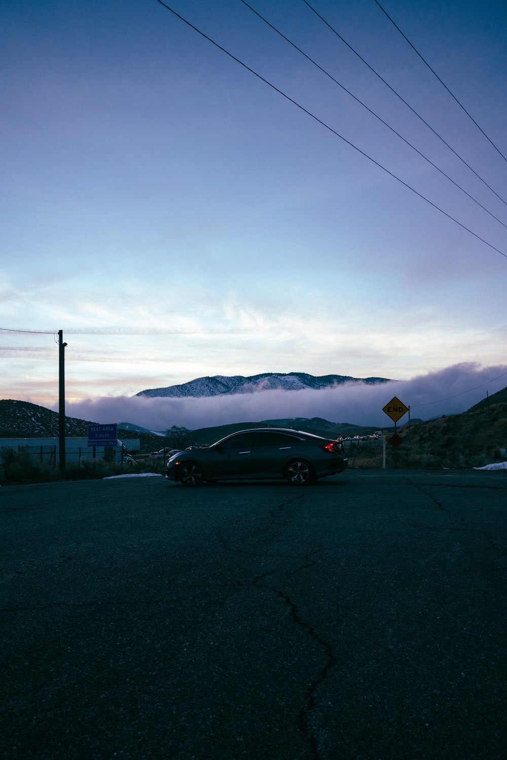 black sedan on road during daytime