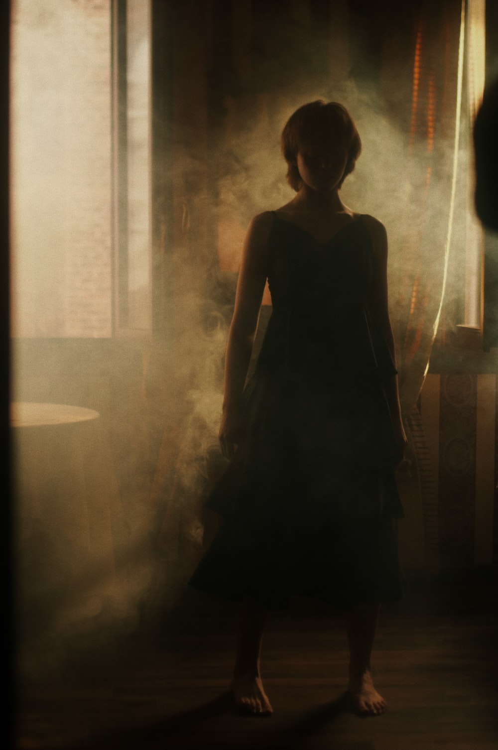 woman in black dress standing on the hallway