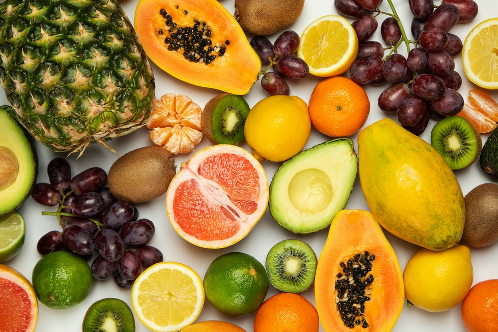 sliced orange fruit and green round fruits