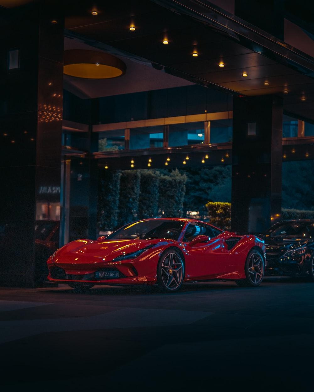 red ferrari 458 italia parked near building