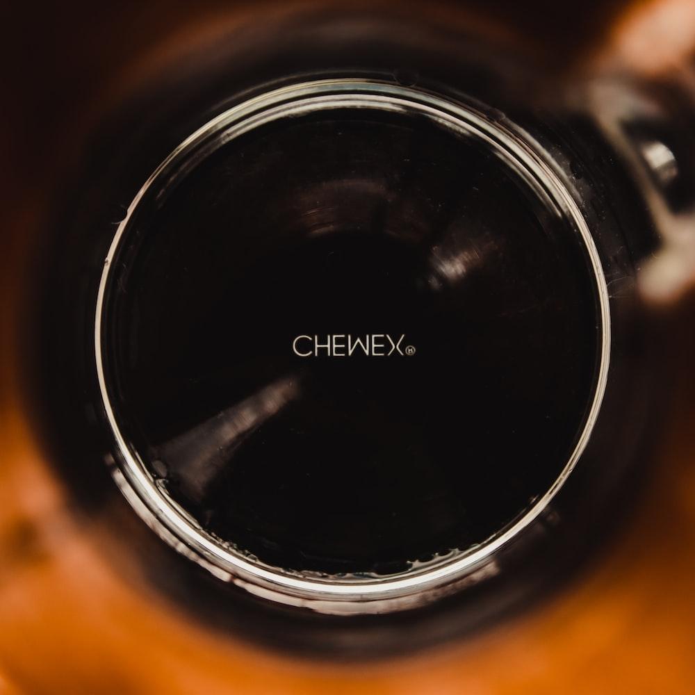 black liquid in clear drinking glass