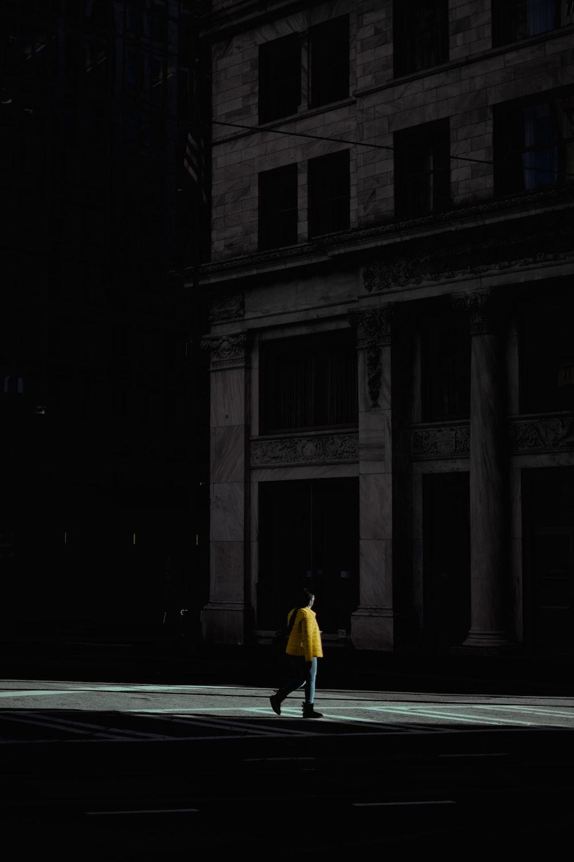 woman in yellow dress walking on street during nighttime