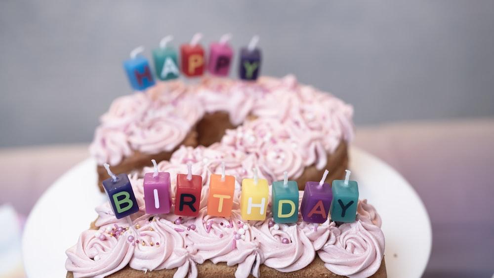 pink and yellow happy birthday cake