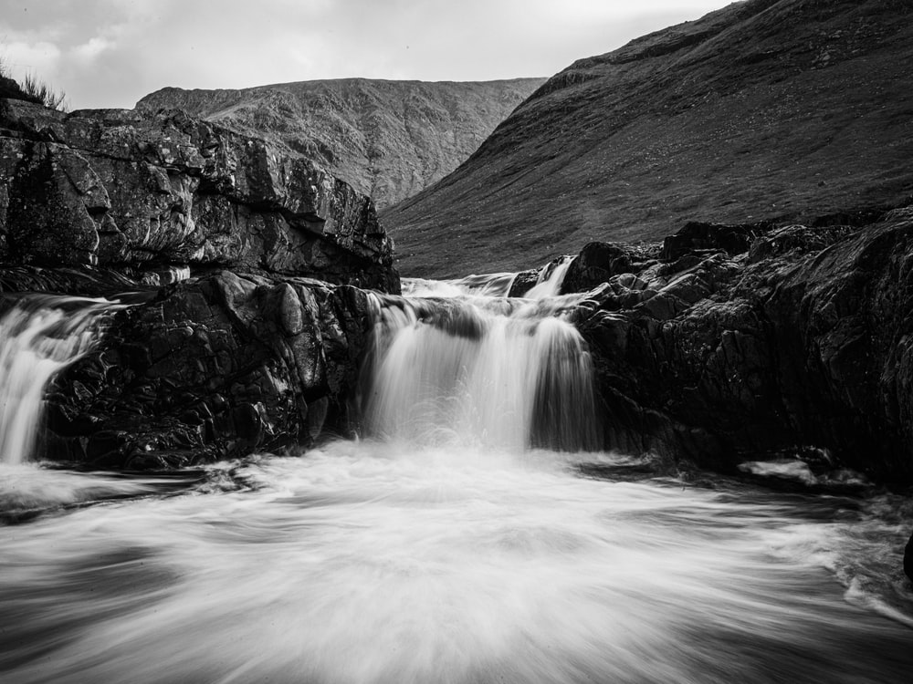 grayscale photo of water falls