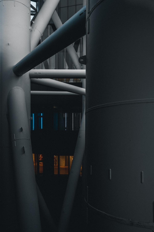 gray metal pipe near building