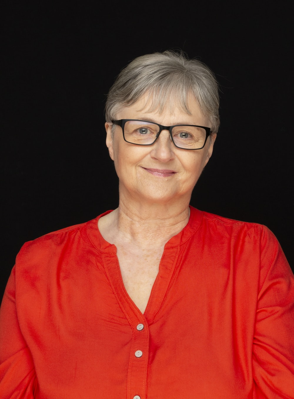 woman in red shirt wearing eyeglasses