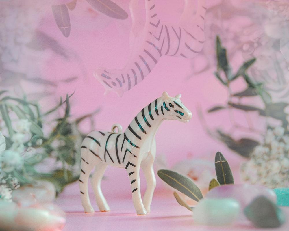 zebra figurine on brown wooden table