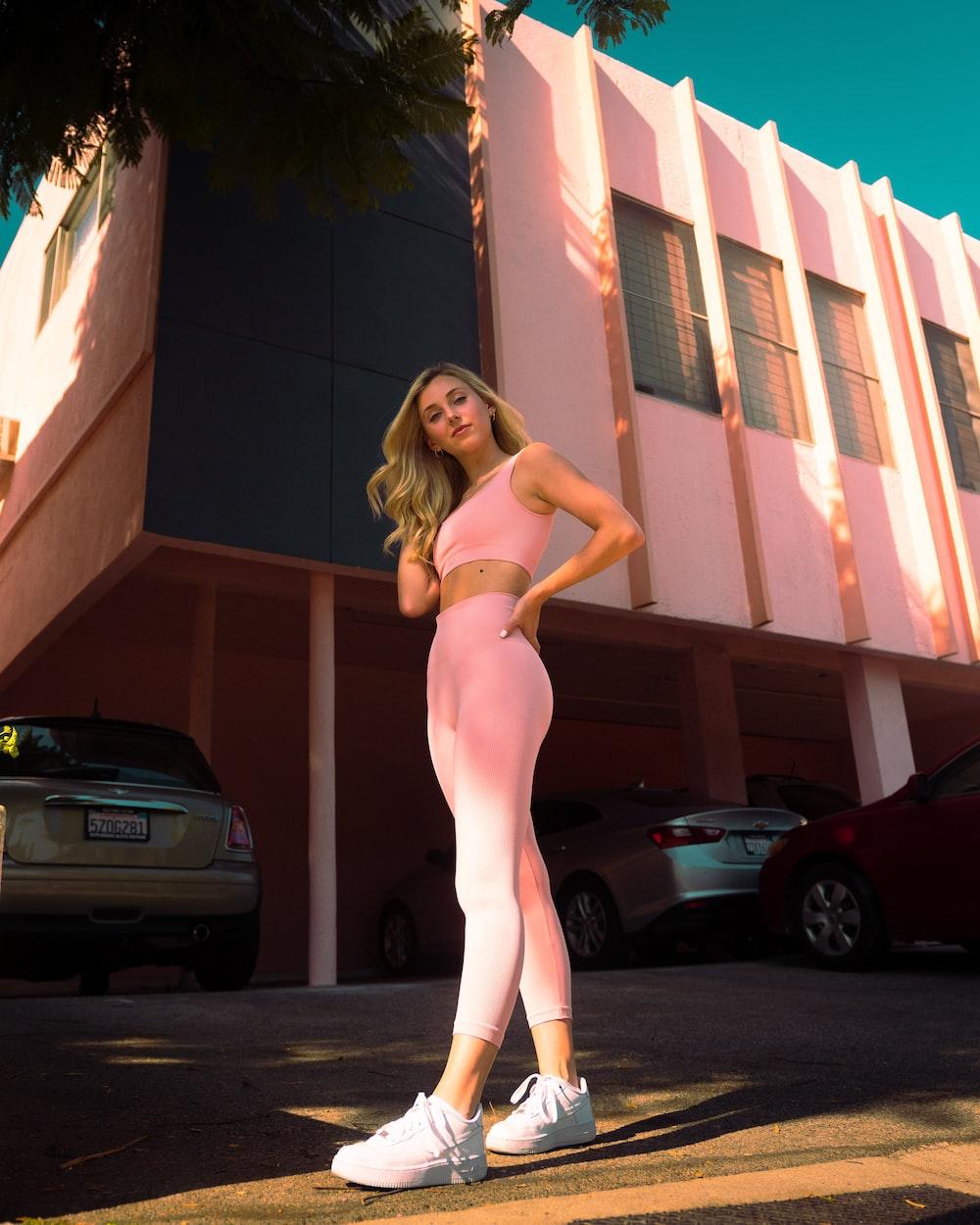 woman in white bikini standing on sidewalk during daytime