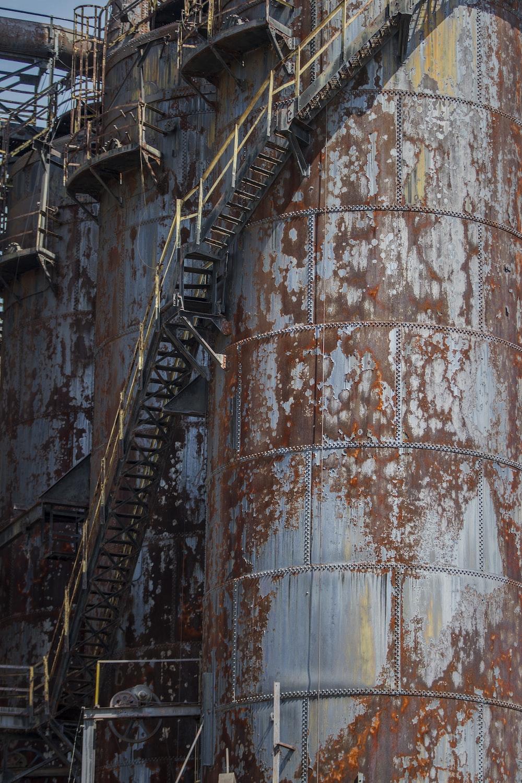 brown steel water tank on brown steel wall