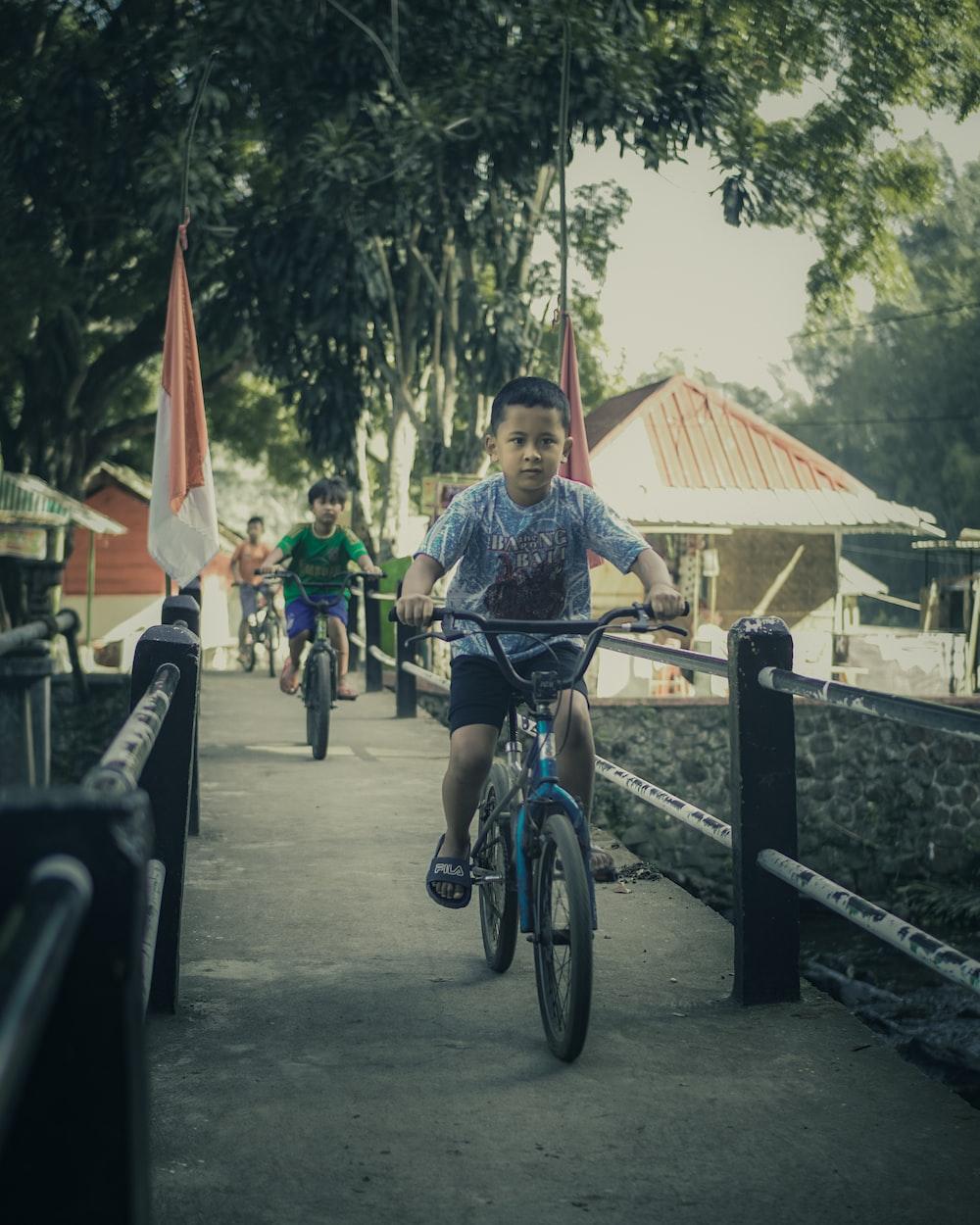 man in blue shirt riding bicycle during daytime