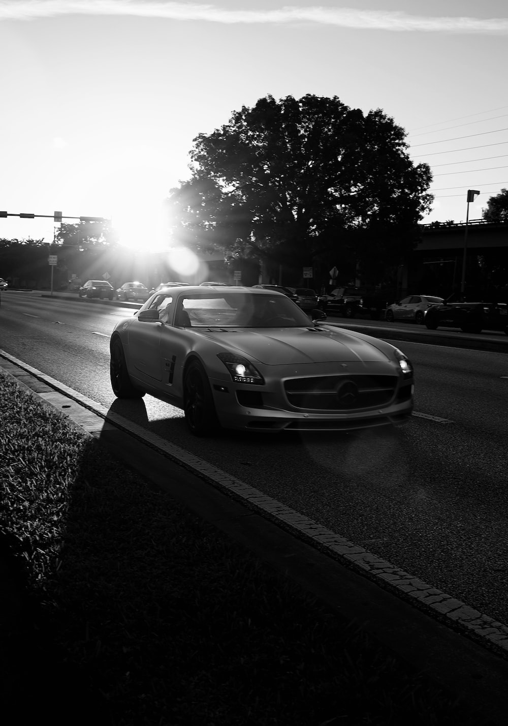 grayscale photo of car on road