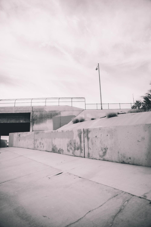 gray concrete wall under gray sky